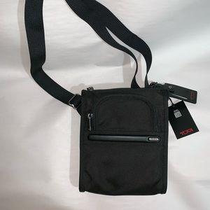 NWT black ballistic nylon TUMI crossbody Traveler